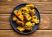 Indian fried assorted pakoras on wooden rustic background
