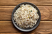 Indian boiled biryani rice with salad with cumin