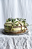 Carrot cake decorated with olive branches, glutenfree
