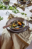 Mediterranean style dinner with Mussels in green sauce and white wine