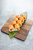 Inside-out sushi with salmon and avocado