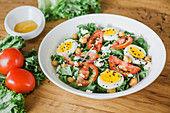 Tomato and lettuce salad with chickpeas and boiled eggs