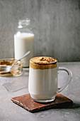 Dalgona frothy coffee (trend korean drink) - milk latte with coffee foam in glass mug