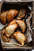 Mini empanadas into a wooden basket