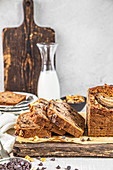 Banana bread with chocolate and walnuts, on a wooden board