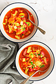 Tomato and vegetable soup with ham hock