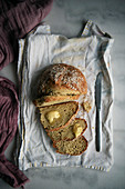 Soda bread without yeast half sliced ona cotton white tea towel