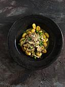 Braised Mutton shank with peas on gnocchi