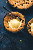 Skillet Chocolate Chip Cookies served with vanilla ice cream