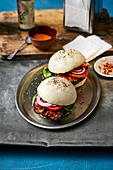 Aubergine and bulgogi burger in a rice flour bun with chilli mayonnaise