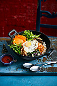 Bibimbap with salmon substitute, vegetables, egg, gochujang paste and rice (Korea)