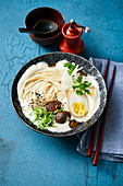 Ramyun soup with soya milk, shoyu egg and shiitake mushrooms (Korea)