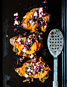 Smashed sweet potatoes with a beetroot and feta cheese salad