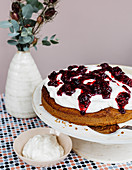 Potato and nut cake with blackberry sauce