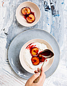 Oven-baked plums on semolina pudding