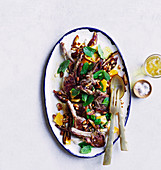 Lamb cutlets with date and almond salad