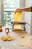Rolling out pastry with pasta machine