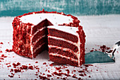 Red velvet cake on wooden table