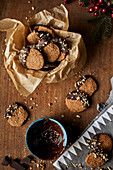 Winter cookies with walnuts dipped in melted chocolate