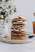Banana pancakes with banana slices and honey