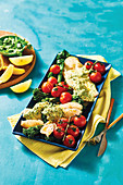Baked hake with parsley sauce and roasted tomatoes