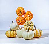A stack of pie pumpkins balanced in a big tower - fall fun