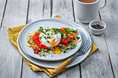 Potato rosti with chorizo, coriander, red pepper dip and poached egg