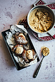 Coffee ice cream sandwich with doughnuts dipped in coocnut