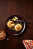 Apricot dumplings with cinnamon crumbs