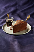 A piece of chocolate mousse cake with coffee