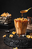 Homemade coffee with caramelized popcorn and salted caramel sauce