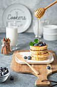 Cottage cheese pancakes with blueberries and honey