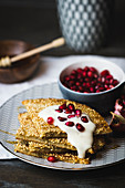 Millet pancakes with pomegranate seeds