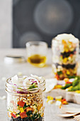 Legume salad with vegetables and parmesan in a glass
