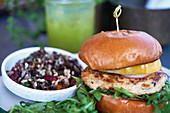 Burger with vegan bean mince patty, bell pepper and rocket