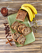 Banana bread with raisins and chocolate drink