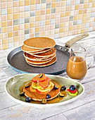 Sweet buckwheat pancakes with date caramel and fruits