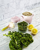 Kale pesto in a glass with various ingredients