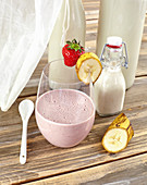 Oat and strawberry shake with strawberry and banana