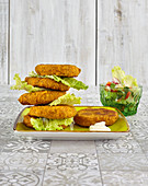 Millet patties with salad and mustard sauce