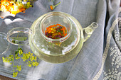 Freshly brewed flower tea in a glass jug