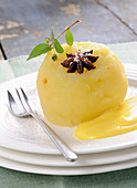 Poached apple with vanilla sauce and star anise