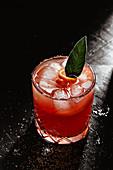 Orange cocktail with sage leaf