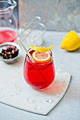 Homemade iced tea with a lemon wedge in a glass