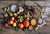 Autumn harvest composition on a rustic wooden table top in the garden