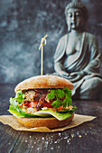 Asian pulled pork burger with green papaya salad and pak choi