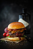 Double grilled Wagyu burger with cheddar, bacon and gin barbecue sauce