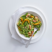 Spaghetti with rocket pesto, zucchini flowers and prawns