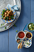 Falafel with tomato dip and mint yogurt