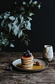 Mini American pancakes with blackberry and maple syrup